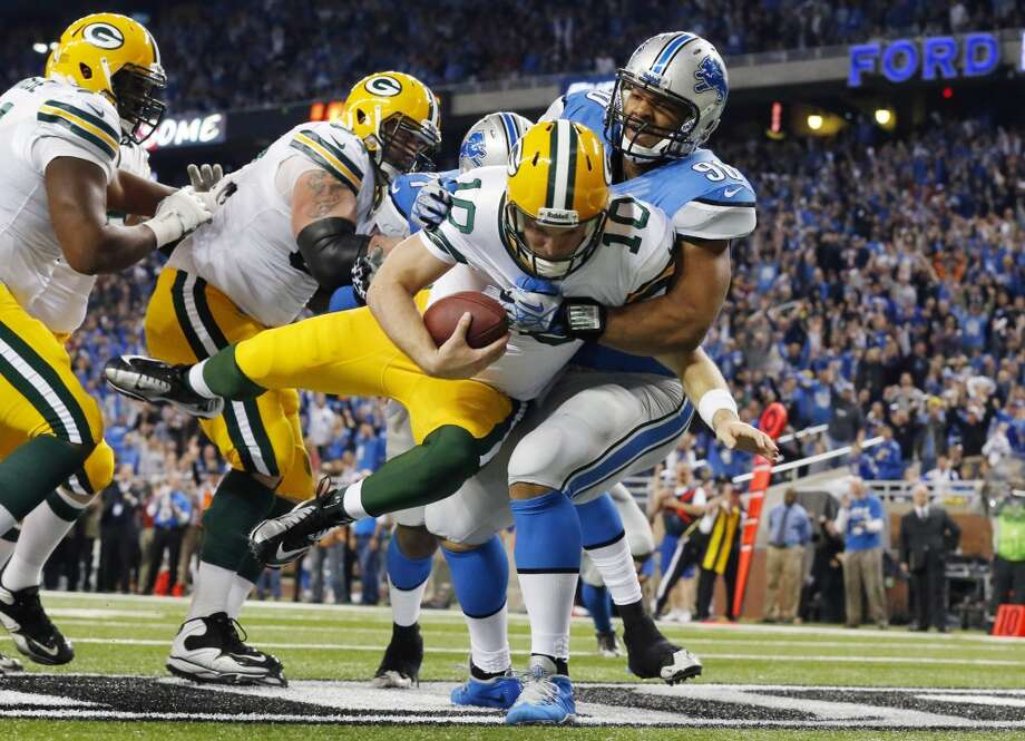 Lions defensive tackle Ndamukong Suh (90) sacks Packers quarterback Matt Flynn for a safety. Photo: Paul Sancya, Associated Press