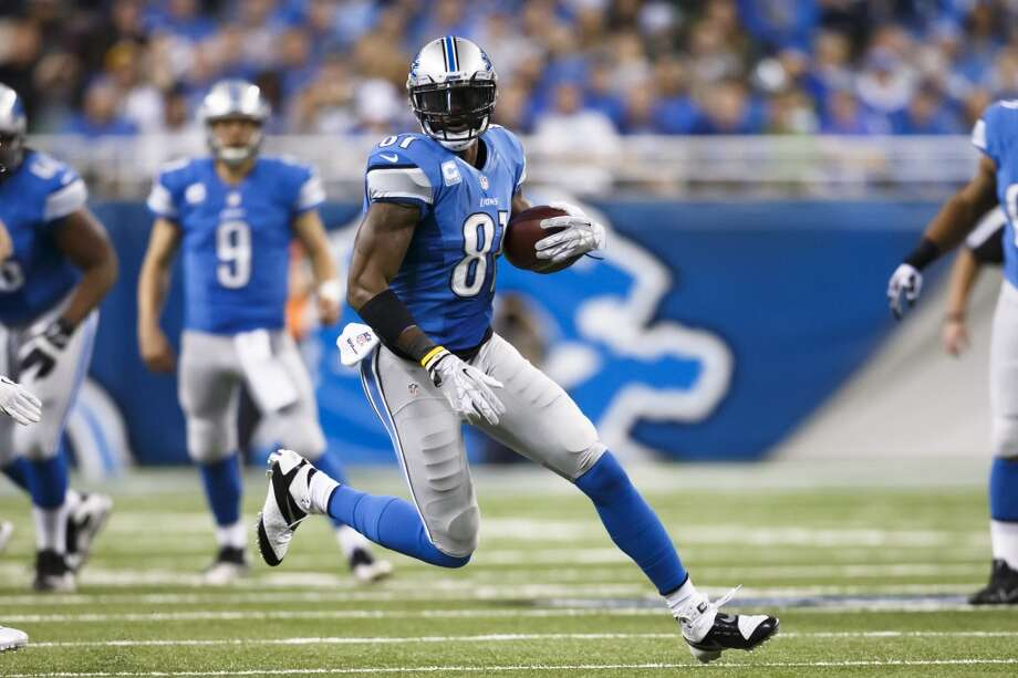 Lions wide receiver Calvin Johnson (81) runs with the ball after a catch. Photo: Rick Osentoski, Associated Press