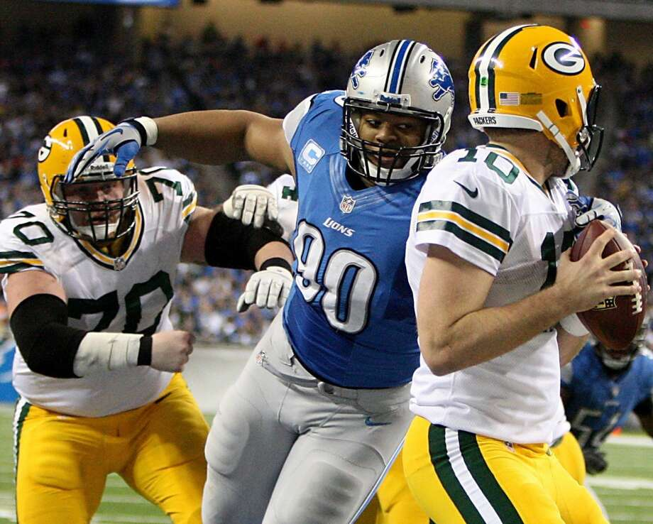 Ndamukong Suh tackles Matt Flynn for a safety. Photo: Kirthmon F. Dozier, McClatchy-Tribune News Service
