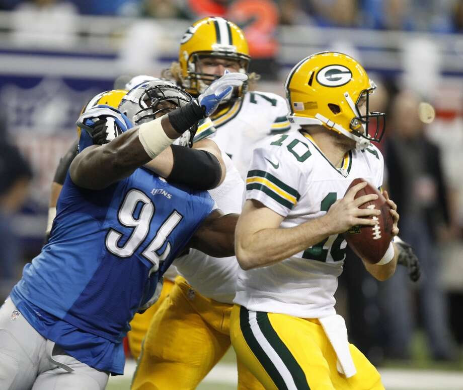 Ezekiel Ansah gets to Packers quarterback Matt Flynn for a sack. Photo: Julian H. Gonzalez, McClatchy-Tribune News Service