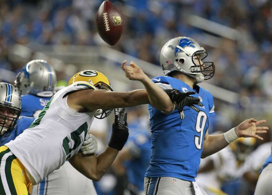 Packers linebacker Nick Perry (53) forces Lions quarterback Matthew Stafford (9) to fumble. Photo: Mark Hoffman, McClatchy-Tribune News Service