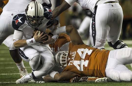 Texas 41, Texas Tech 16 Record: 8-3  Texas Longhorns' Jackson Jeffcoat, right, brings down Texas Tech Red Raiders' Baker Mayfield, left, for a sack during the first half at Darrell K Royal - Texas Memorial Stadium in Austin, Texas, on Thursday, Nov. 28, 2013. Photo: Rodolfo Gonzalez, McClatchy-Tribune News Service