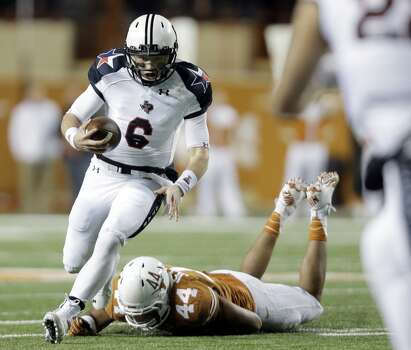 Texas Tech's Baker Mayfield (6) runs past Texas defender Jackson Jeffcoat (44) during the first half of an NCAA college football game Thursday, Nov. 28, 2013, in Austin, Texas. Photo: Eric Gay, Associated Press