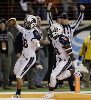 Texas Tech punter Ryan Erxleben (26) runs across the goal line with teammate Eric Ward (18) as he scores on a fake punt during the first half of an NCAA college football game against Texas, Thursday, Nov. 28, 2013, in Austin, Texas. Photo: Eric Gay, Associated Press