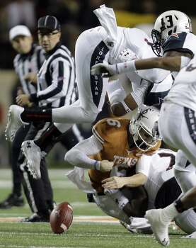 Texas' Case McCoy (6) fumbles the ball during the first half of an NCAA college football game against Texas Tech, Thursday, Nov. 28, 2013, in Austin, Texas. Texas kept possession of the ball. Photo: Eric Gay, Associated Press