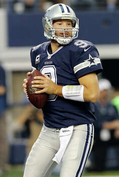 Dallas Cowboys' Tony Romo looks to pass against the  Oakland Raiders during first half action Thursday Nov. 28, 2013 at AT&T Stadium in Arlington, Tx. Photo: Edward A. Ornelas, San Antonio Express-News / © 2013 San Antonio Express-News