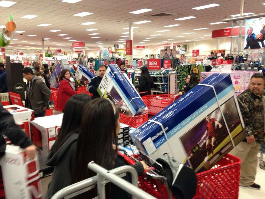 Gray Thursday shoppers snatch up the big screen TVs at the Super Target off Bandera Road and Loop 1604 on Thanksgiving night, Nov. 28, 2013. Photo: Vianna Davila / San Antonio Express-News