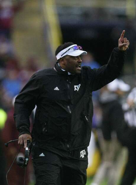 A&M coach Kevin Sumlin appears to be in line for another raise — from the Aggies or someone else. Photo: Cody Duty / Houston Chronicle