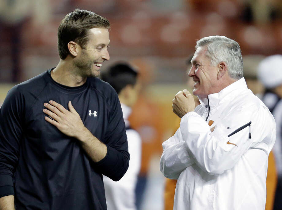 Texas Tech coach Kliff Kingsbury, left, talks with Texas coach Mack Brown, right, before an NCAA college football game on Thursday, Nov. 28, 2013, in Austin, Texas. (AP Photo/Eric Gay) Photo: Eric Gay, Associated Press / AP