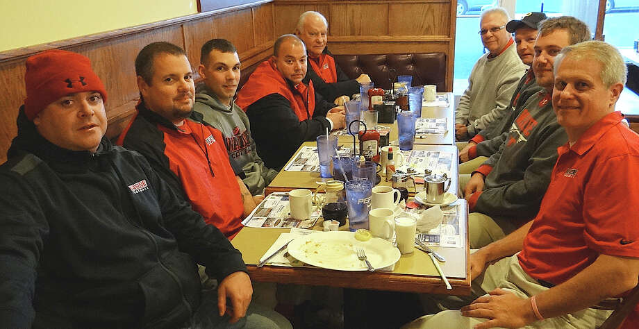 Fairfield Warde High School football coaches enjoy a pancake breakfast Thursday at Chip's Family Restaurant, proceeds from which benefited Operation Hope, before their team took on cross-town rival Fairfield Ludlowe in their annual Thanksgiving game. Photo: Mike Lauterborn / Fairfield Citizen contributed