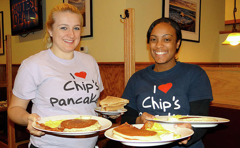 Samantha Letourneau and Timish Graham shuttle pancakes from the kitchen at Chip's Family Restaurant, site of a Thanksgiving Day pancake breakfast Thursday with proceeds benefiting Operation Hope. Photo: Mike Lauterborn / Fairfield Citizen contributed
