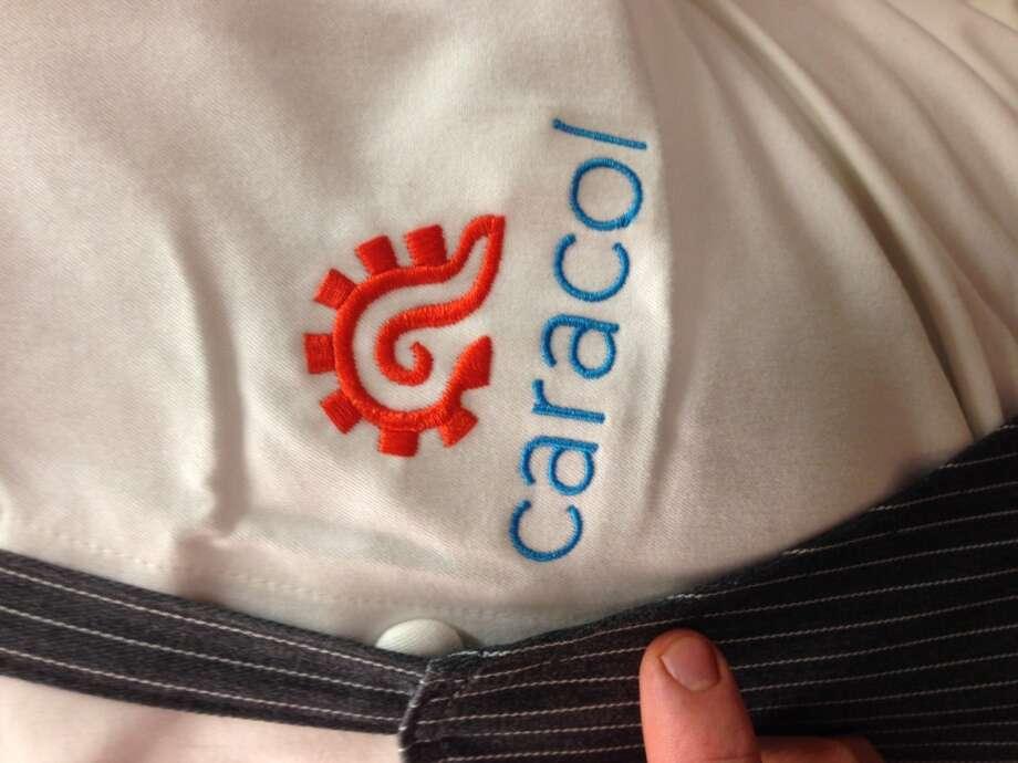 Caracol's logo on kitchen whites. (Photo: Greg Morago)