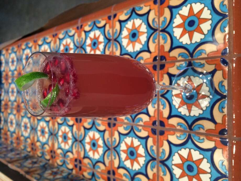 """The Blushing"" – a cocktail made with cava, pomegranate, ginger liqueur and lime from Sean Beck at Caracol, the new restaurant from Tracy Vaught and Hugo Ortega. (Photo: Paula Murphy)"
