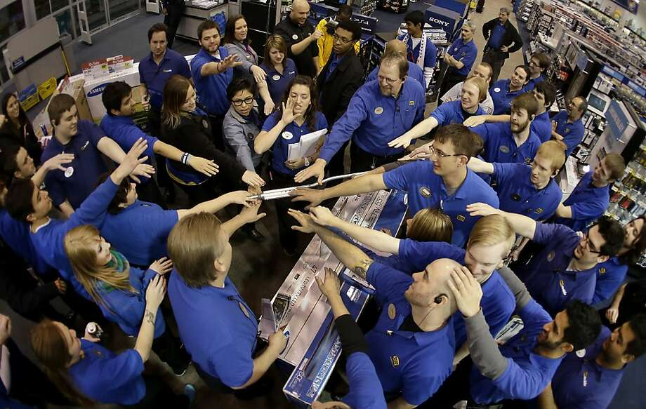 Congratulations, you all are Best employees of the month! Best Buy employees huddle up before opening the store to hordes of shoppers Thursday night in Overland Park, Kan. Instead of waiting for Black Friday, more than a dozen major retailers are opened on Thanksgiving. Photo: Charlie Riedel, Associated Press