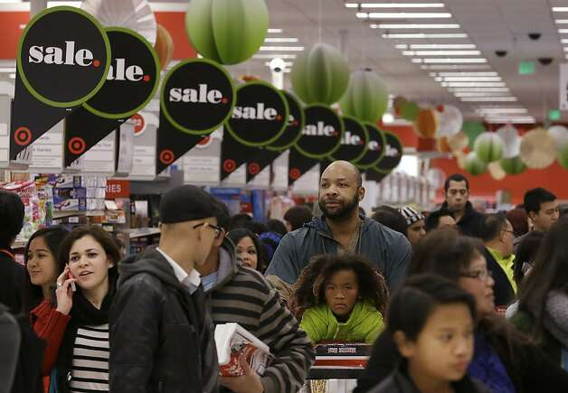 People shop at a Target store in Colma, Calif., Thursday, Nov. 28, 2013. Instead of waiting for Black Friday, which is typically the year's biggest shopping day, more than a dozen major retailers opened on Thanksgiving day this year. (AP Photo/Jeff Chiu) Photo: Jeff Chiu, Associated Press