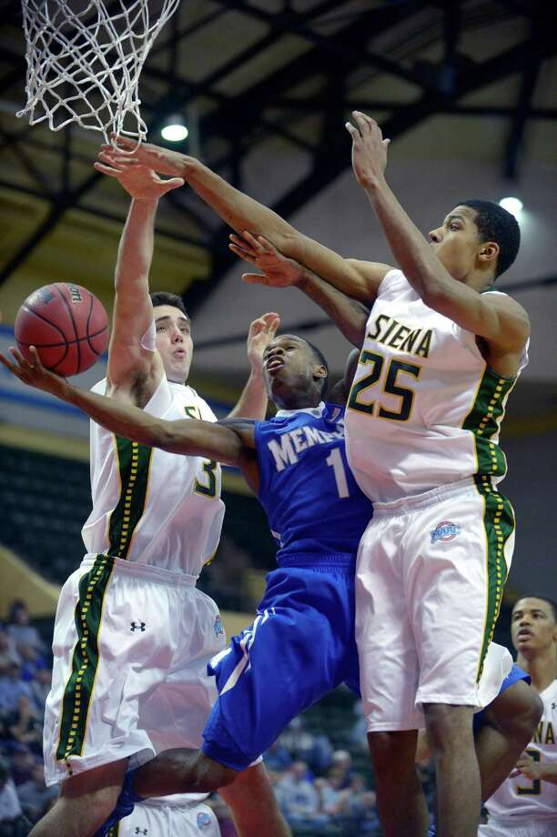 Memphis guard Joe Jackson (1) goes up for a shot between Siena's Brett Bisping, left, and Michael Wolfe (25) during the first half of an NCAA college basketball game in Kissimmee, Fla., Thursday, Nov. 28, 2013. (AP Photo/Phelan M. Ebenhack) ORG XMIT: FLPE202 Photo: Phelan M. Ebenhack, AP / FR121174 AP