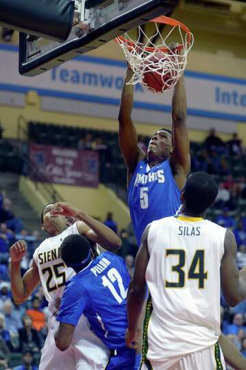 Memphis forward Nick King (5) dunks the ball over Siena's Michael Wolfe (25) and Imoh Silas (34) as