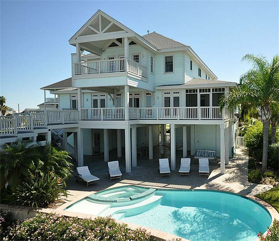 This 5 bedroom, 5-1/2 bathroom home is located on the bay in Galveston's Enclave of Pirates Cove. For more information, contact agent Kelly Kelley. Photo: HAR.com