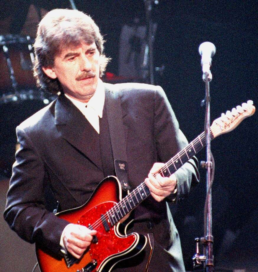 ** FILE ** In this April 6, 1995 file photo, George Harrison performs in London. (AP Photo, file) Photo: AP