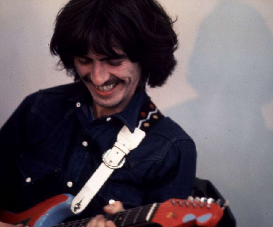 """CONDITIONS OF USE: This Apple Corps Ltd copyright image may only be used in 2001 in relation to tributes to George Harrison.    FILE--Beatle George Harrison is seen during the making of the film """"Let It Be"""" in this 1969 file photo. Harrison died at the home a friend in Los Angeles, Thursday Nov. 29, 2001, at the age of 58, after a battle with cancer. (AP Photo/Apple Corps Ltd/Ethan Russell) CONDITIONS OF USE: This Apple Corps Ltd copyright image may only be used in 2001 in relation to tributes to George Harrison. No promotional use permitted.  Use must be credited: Copyright Apple Corps Ltd.  COMMERCIAL INTERNET OUT. Photo: AP"""