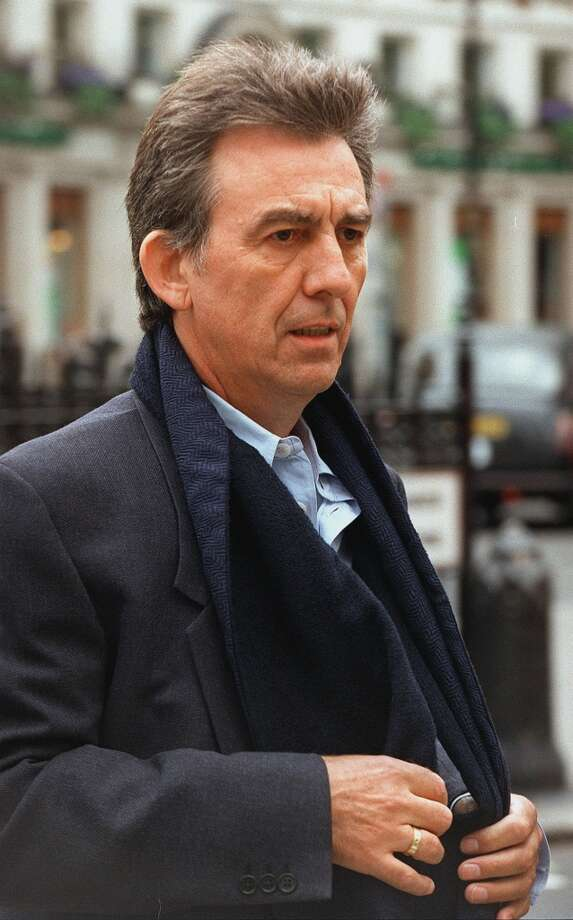 FILE- Former Beatle George Harrison arrives at the High Court in London in this Wednesday, May 6, 1998, file photo to give evidence in a court action to recover an amateur recording made of the Beatles in Hamburg, Germany, in 1962. It was announced Thursday Nov. 29, 2001, that Harrison died at a friend's home in Los Angeles following a battle with cancer  (AP Photo/Dave Thomson).     HOUCHRON CAPTION (12/04/2001):  Harrison.     HOUCHRON CAPTION (11/30/2002): Harrison, 1998. Photo: AP