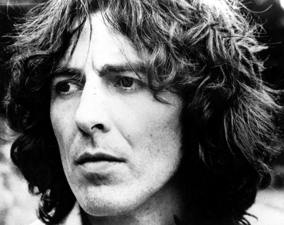 FILE--George Harrison is shown in this 1976 file photo at an unknown location. Harrison died Thursday, Nov. 29, 2001, a longtime family friend said. He was 58.  (AP Photo).     HOUCHRON CAPTION (12/01/2001):  The Beatles, which included George Harrison, performed in Houston on Aug. 19, 1965.  HOUCHRON CAPTION (03/16/2004):  GEORGE HARRISON. Class of 2004 / ROCK AND ROLL HALL OF FAME INDUCTS HANDFUL OF HEAVIES. Photo: AP