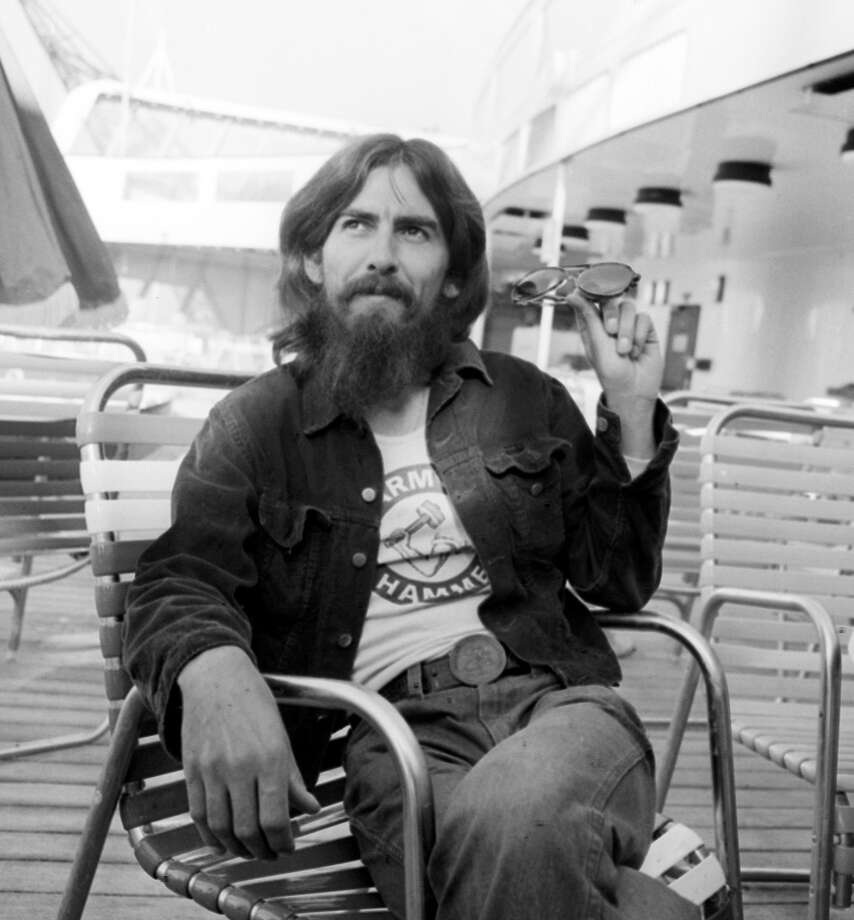 FILE--George Harrison sits aboard the Queen Elizabeth II ocean liner from New York after 3 months recording in America in this Sept. 8, 1971 file photo. Harrison died Thursday Nov. 29, 2001, a longtime family friend said. He was 58. (AP Photo/PA) UNITED KINGDOM OUT   NO SALES    MAGAZINES OUT Photo: AP