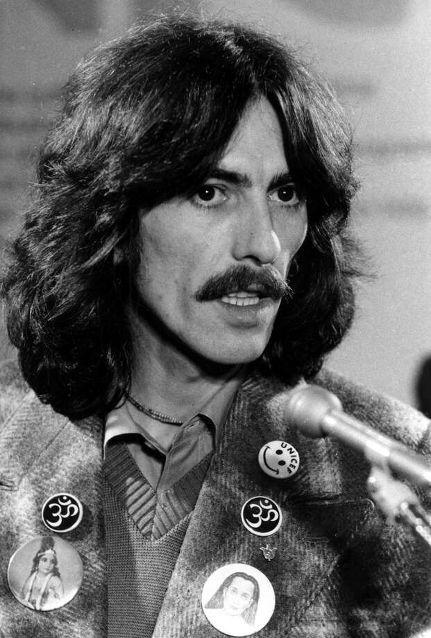FILE--British musician George Harrison gives a news conference at the United Nations in New York Thursday, in this Dec. 19, 1974, photo.  Harrison died Thursday, Nov. 29, 2001, a longtime family friend said. He was 58. (AP Photo/Suzanne Vlamis, File).     HOUCHRON CAPTION (12/01/2001):  Harrison became the first Beatle to stage a solo world tour in 1974. Photo: AP
