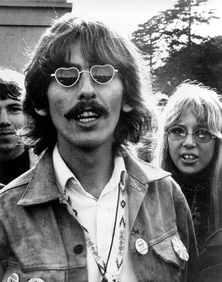 FILE--George Harrison, wearing heart-shaped sunglasses, is shown with his wife, Patti Boyd, in San Francisco in this Aug. 8, 1967 file photo.  Harrison died Thursday, Nov. 29, 2001, in Los Angeles following a battle with cancer. He was 58.  (AP Photo/File) Photo: AP