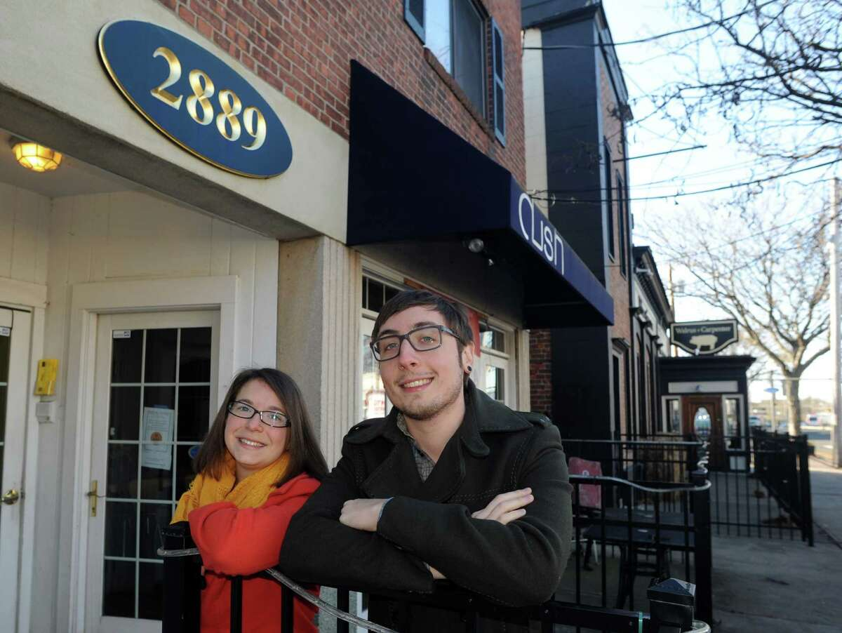 Courtney & Matthew Hartl stand in front of the spot where they will open Source Coffeehouse in the Black Rock section of Bridgeport, Conn. on Friday, Nov. 29, 2013.