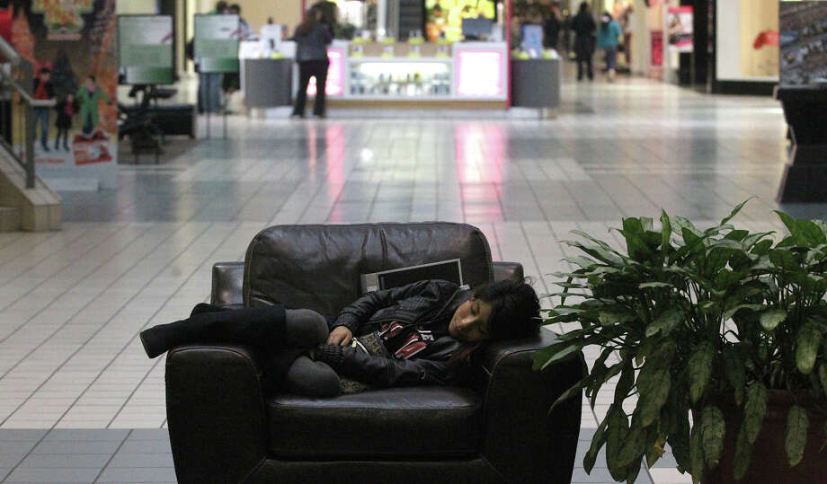 Esme De la Cruz,17, snoozes on a chair Black Friday November 29, 2013 at Ingram Park Mall after shopping. De la Cruz also shopped on Gray Thursday. Photo: JOHN DAVENPORT, John Davenport / San Antonio Express-News / ©San Antonio Express-News/Photo may be sold to the public