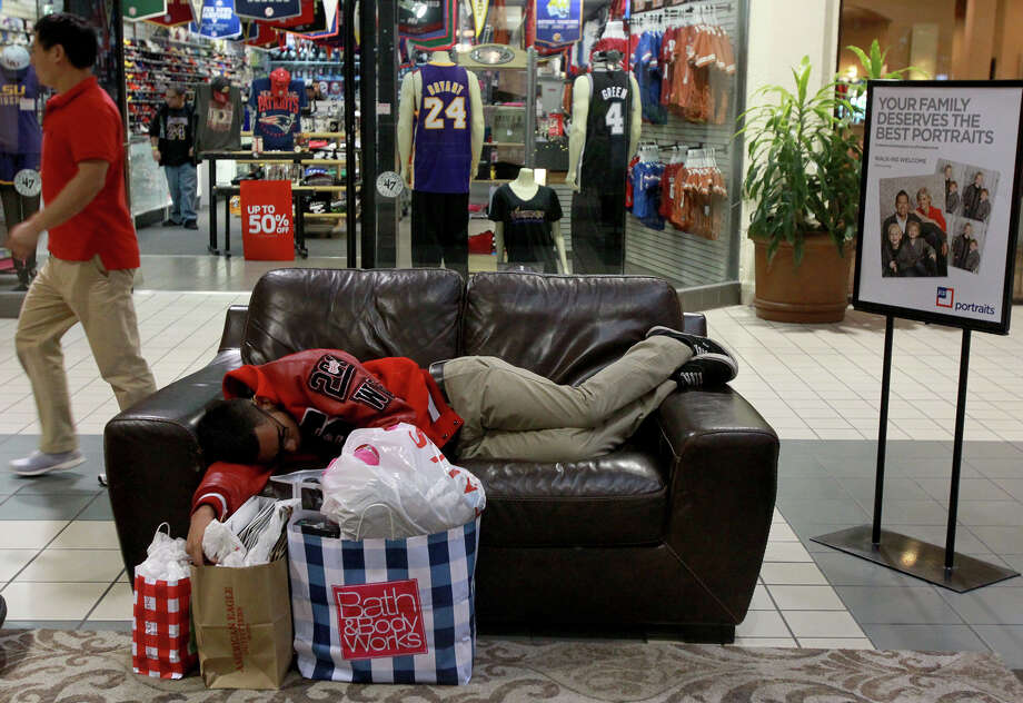 Noah Rangel,18, snoozes on a couch Black Friday November 29, 2013 at Ingram Park Mall after shopping. Rangel also shopped on Gray Thursday. Photo: JOHN DAVENPORT, John Davenport / San Antonio Express-News / ©San Antonio Express-News/Photo may be sold to the public
