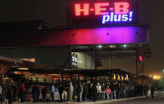 Customers line up Black Friday November 29, 2013 at the H-E-B Plus! on North Loop 1604 West near Bandera Road before it opened at 6:00 a.m. . Electronics and big screen TVs were popular items when the doors opened. Photo: JOHN DAVENPORT, John Davenport / San Antonio Express-News / ©San Antonio Express-News/Photo may be sold to the public