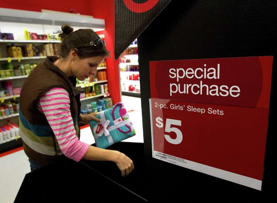 Jenny Dye shops during Black Friday at Target, Nov. 29, 2013, in Houston. Dye said she was just looking for sales. Photo: Cody Duty, Houston Chronicle / © 2013 Houston Chronicle