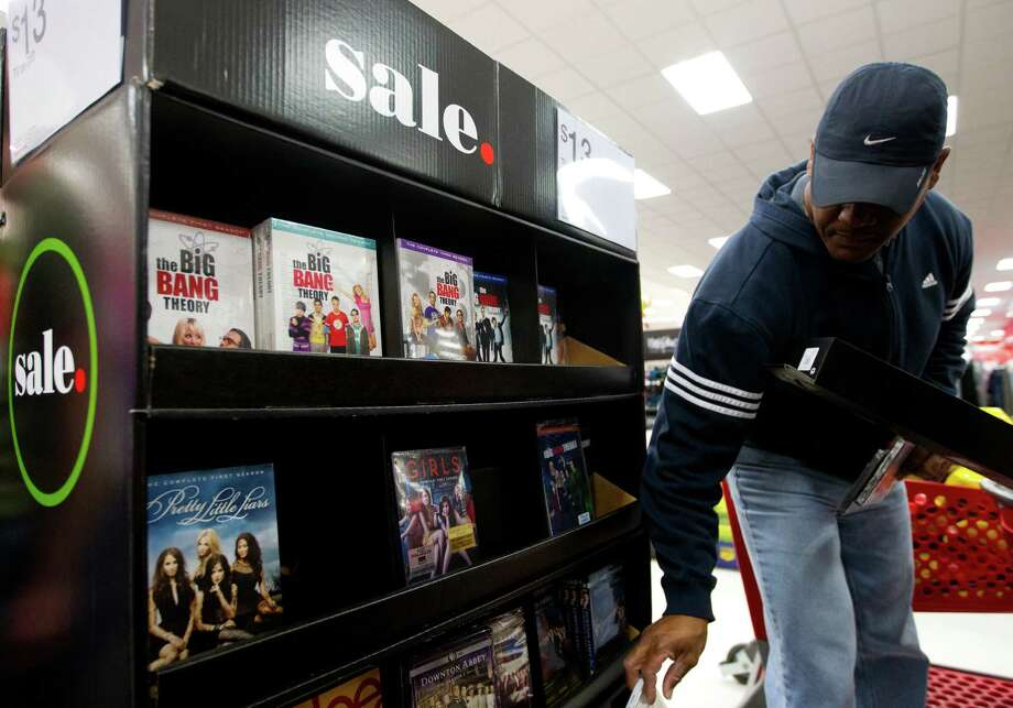 """Billy Rivers looks at movies on sale at Target during Black Friday, Nov. 29, 2013, in Houston. """"I'm enjoying them for whatever I need,"""" he said of the sales. """"I need to look for a few more things and hopefully get a good price on those."""" Photo: Cody Duty, Houston Chronicle / © 2013 Houston Chronicle"""