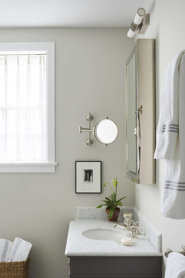 Double-hung towel rods in the guest bathroom hold plenty of white terry towels. Photo: Dylan Chandler / Washington Post