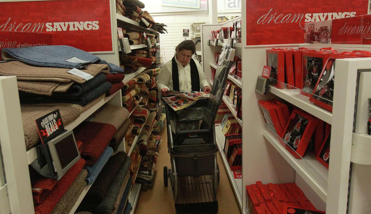 Silvia Estrada looks at advertisements while shopping at Kohl's on Bandera Road Black Friday November 29, 2013.