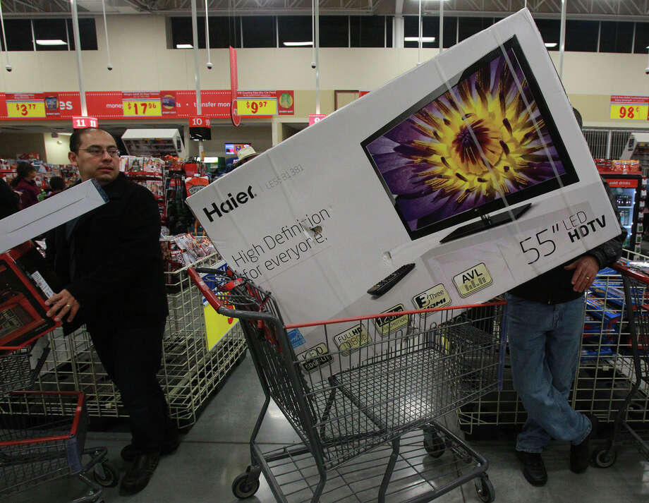 Flat screen TVs (right) are a very popular item at the H-E-B Plus! store on North Loop 1604 West near Bandera road on Black Friday November 29, 2013. Daniel Mitzelman (right) waits in line to purshase his. Photo: JOHN DAVENPORT, John Davenport / San Antonio Express-News / ©San Antonio Express-News/Photo may be sold to the public