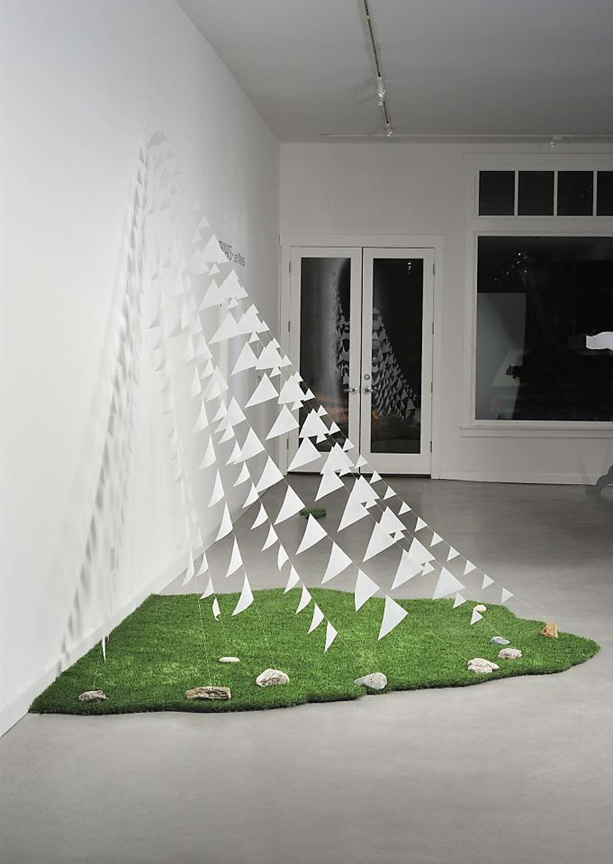 Leah Markos' Pennants Alcove vellum (archival), faux lawn, stones 114 w x 93 d x approx 9 ft h2013