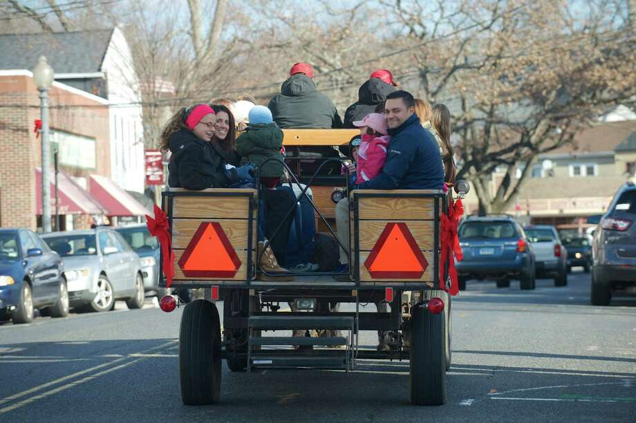Horse drawn carriage rides, part of Bethel WinterFest, in Bethel, Conn, on Friday November 29, 2013. The rides were  sponsored by Union Savings Bank. Photo: H John Voorhees III / The News-Times Freelance
