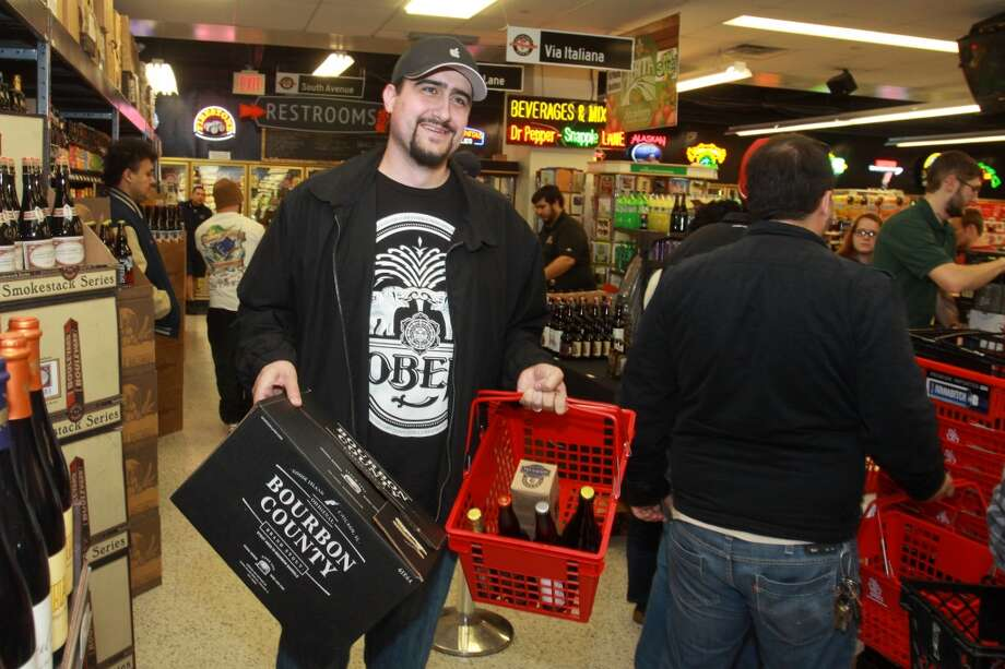 Kris Stivers at Spec's Wines, Spirits and Beer on Smith Street after purchasing a beer Spec's was releasing for the first-time-in-Texas, called Bourbon County Brand Stout, from Goose Island Beer Co. Photo: Gary Fountain, For The Chronicle