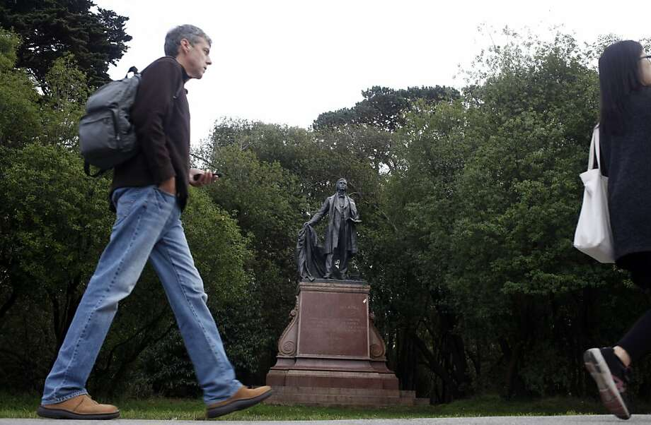 Passersby stroll in front of the statue of Thomas Starr King in Golden Gate Park. Starr King inspired San Franciscans to help build what became the Red Cross. Photo: Lacy Atkins, The Chronicle