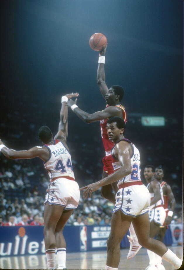 Hakeem Olajuwon #34 of the Houston Rockets shoots over Rick Mahorn #44 of the Washington Bullets during an NBA basketball game circa 1985 at the Capital Centre in Baltimore, Maryland. Olajuwon played for the Rockets from 1984-02.  Photo: Focus On Sport, Getty Images / 1985 Focus on Sport