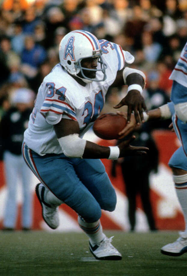 Running back Earl Campbell #34 of the Houston Oilers takes the handoff against the New England Patriots during an NFL game October 18, 1981 at Schaefer Stadium in Foxboro, Massachusetts. Campbell played for the Oilers from 1978-84. (Photo by Focus on Sport/Getty Images) Photo: Focus On Sport, Getty Images / 1981 Focus on Sport