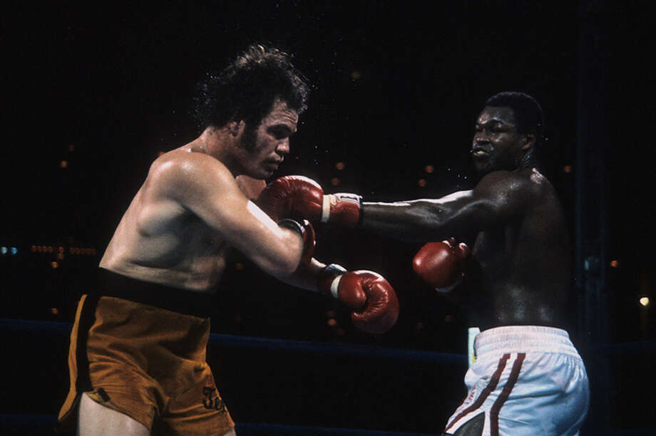 Larry Holmes (R) lands a punch against Randall Cobb during the Nov. 26, 1982 fight at the Astrodome in Houston, Texas. Larry Holmes won the WBC heavyweight title by a UD 15. (Photo by: The Ring Magazine/Getty Images) Photo: The Ring Magazine, The Ring Magazine/Getty Images / 2013 The Ring Magazine