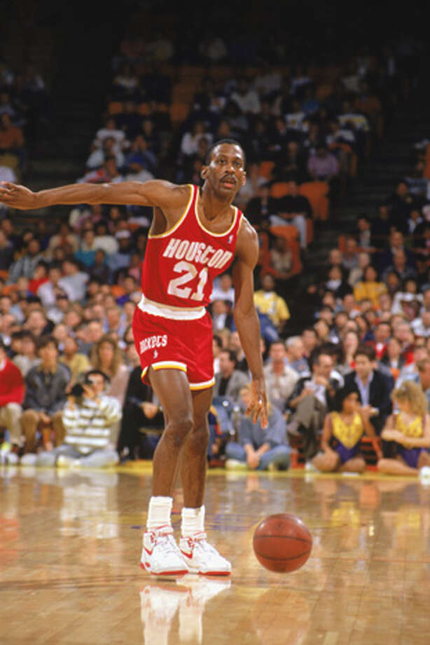Eric Floyd #21 of the Houston Rockets advances the ball during a game in the1989-90 season against the Los Angeles Lakers.  Photo: Ken Levine, Getty Images / 1989 Getty Images
