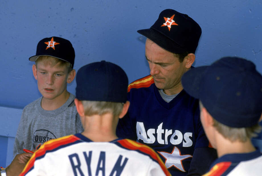 Nolan Ryan of the Houston Astros signs autographs during a season game circa 1988. Nolan Ryan played for the Houston Astros from 1980-1988. (Photo by Andrew D. Bernstein/Getty Images) Photo: Andrew D. Bernstein, Getty Images / 1988 Andrew D. Bernstein