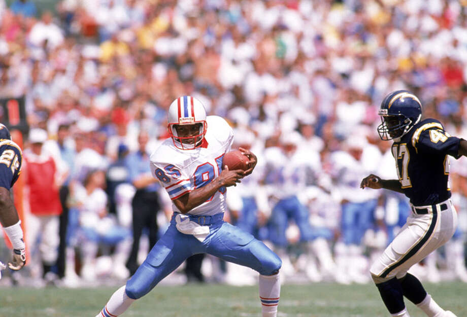Wide Receiver Drew Hill #82 of the Houston Oilers battles to run the ball against the San Diego Chargers defensive line at Qualcomm Stadium on September 17, 1989. The Oilers won 34-27. (Bernstein Associates/Getty Images) Photo: Bernstein Associates, Getty Images / 1989 Bernstein Associates