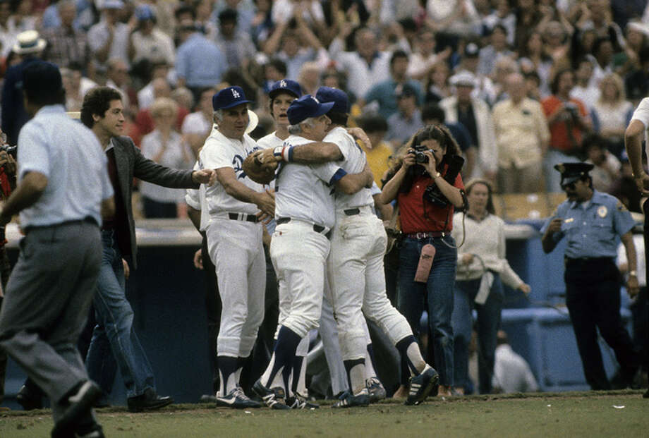 Los Angeles Dodgers managers Tommy Lasorda, left, hugs Steve Garvey, right, on the field after beating the Houston Astros in game 5 of the NLDS, October 11, 1981 at Dodgers Stadium in Los Angeles, California. The Dodgers won the series 3-2. Lasorda managed the Dodgers from 1976-96. Steve Garvey played for the Dodgers from 1969-82. (Photo by Focus on Sport/Getty Images) Photo: Focus On Sport, Getty Images / 2008 Focus on Sport