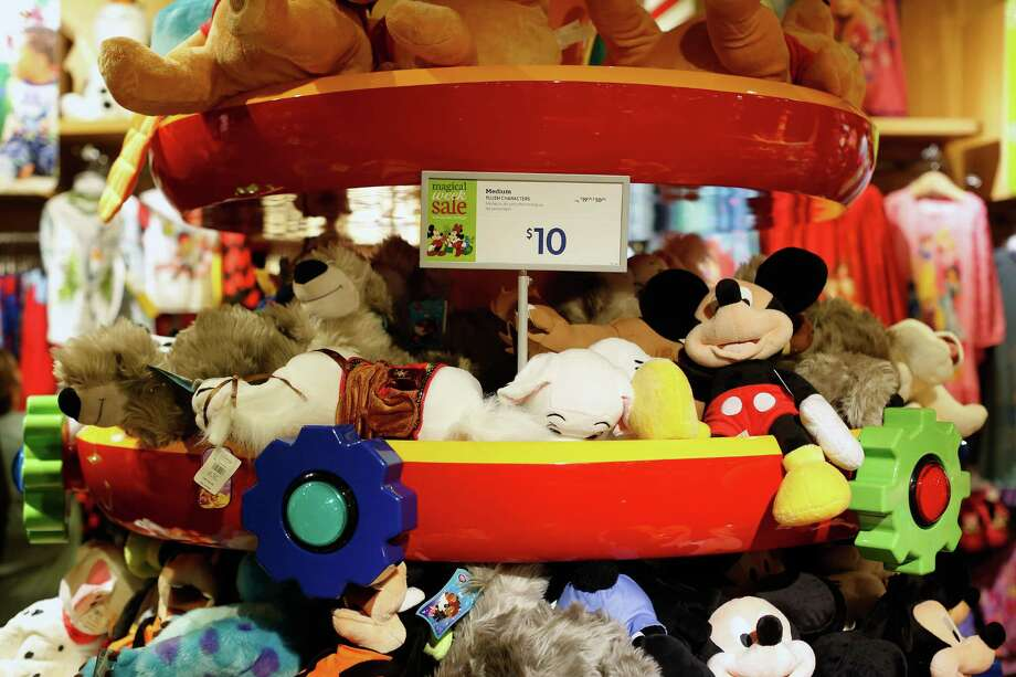 """A display of plush stuffed animals are seen, Friday, November 29, 2013 during The Disney Store's Black Friday """"magical sale"""" at the Galleria mall in Houston, Texas. The sale featured 20% off every item in the store along with other deals. (TODD SPOTH FOR THE CHRONICLE) Photo: © TODD SPOTH, 2013 / © TODD SPOTH, 2013"""